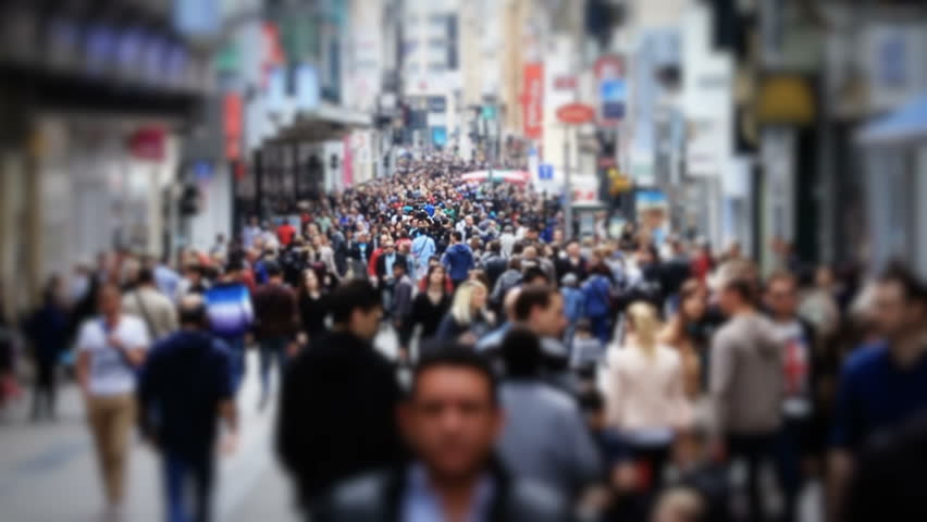 Slow motion city pedestrian traffic shot on a busy Brussels shopping street using a tilt shift effect and added color correction.