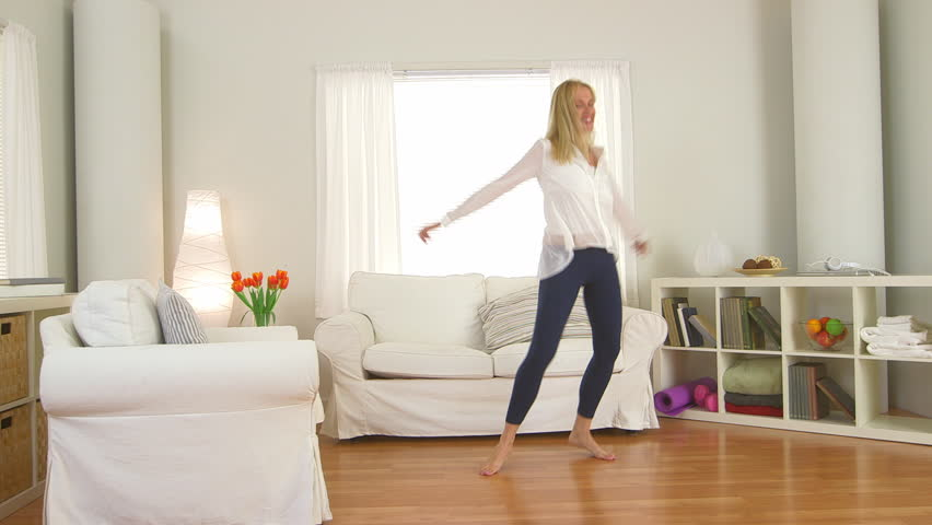 Mature Woman Jumping On Couch Stock Footage Video 100