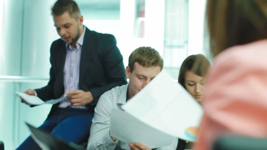 Female manager gives paper a team of professionals. She instructs each employee | Shutterstock HD Video #5026049