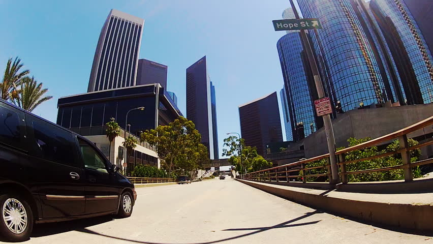 LOS ANGELES, CA: September 3, 2013- Wide, point of view vehicle shot in downtown, circa 2013 in Los Angeles. This clip features the cool buildings and bridges leading into a newer section of downtown.