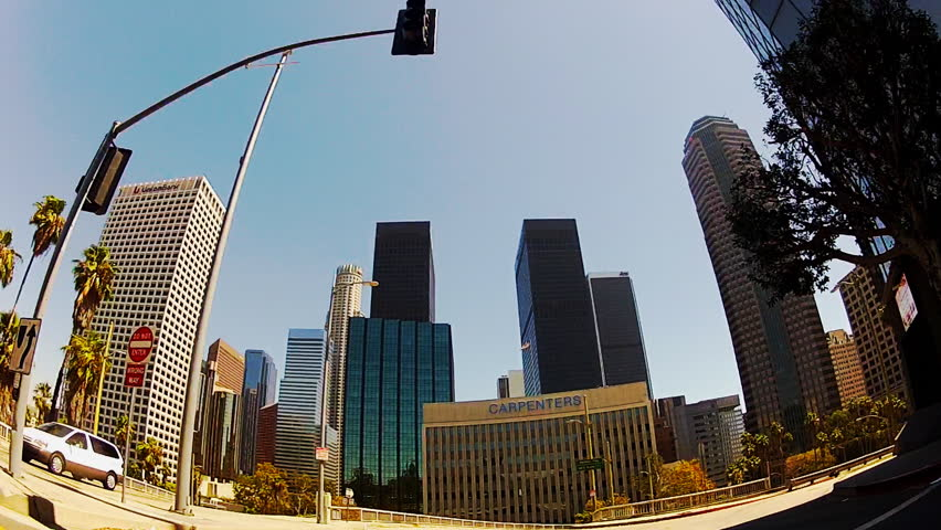 LOS ANGELES, CA - SEPTEMBER 3, 2013: Low angle first person view from a car approaching the downtown area circa 2013 in Los Angeles. Shows a view heading into an inner city, urban area of commerce. | Shutterstock HD Video #5033540