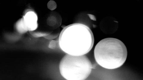 Circular white lights on black background in time-lapse video - white bokeh with movements effects - HDTV H.264 codec