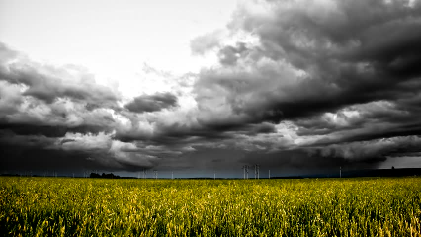 dramatic hd time-lapse storm over grain field