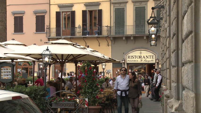FLORENCE, ITALY - 2010: People walking and dining in outdoor cafe