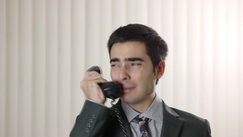 Frustrated man on the phone.