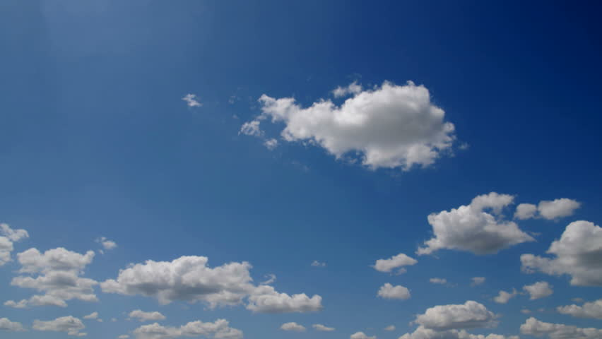 Seamless HD 1080p Time lapse clouds over blue sky captured with 12mpix DSLR camera. Film flicker noticeable.