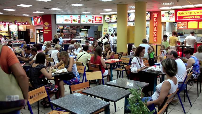 UKRAINE, KIEV, JULY 15, 2010: People eat and drink in fast food restaurant in Kiev, Ukraine, July 15, 2010