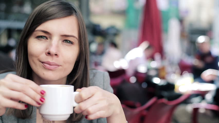 Pretty businesswoman drinking coffee and relaxing in cafe  | Shutterstock HD Video #5172965