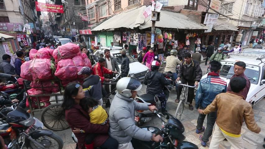 KATHMANDU, NEPAL - DEC 1 2013: Traffic jam in one of a busy street in the city