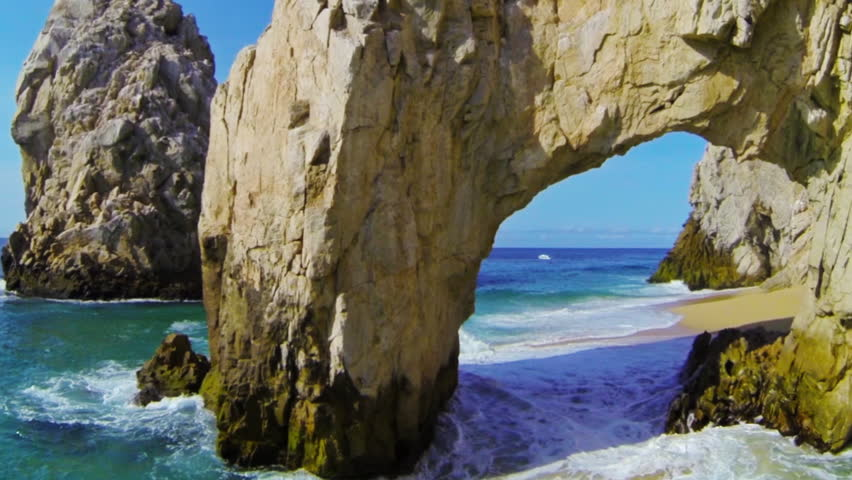 Stunning aerial fly around both sides of the famous landmark, The Arch, at Lands End in Cabo San Lucas, Mexico