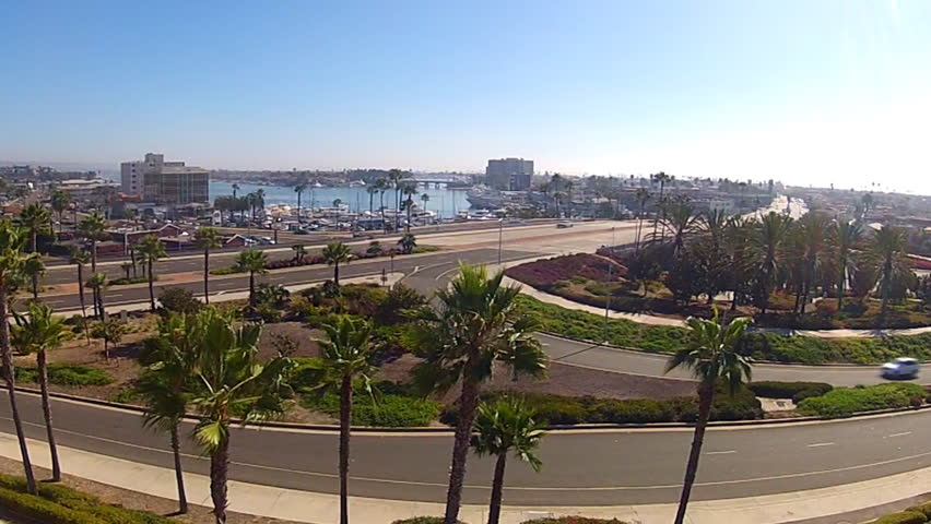 High Angle, wide shot of Newport Beach, California. This shot features a view of the busy traffic pattern in this Orange County, Southern California City.