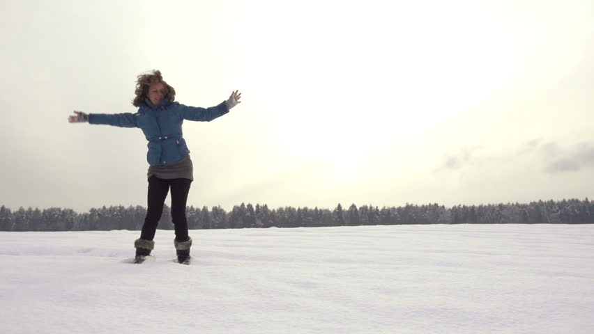 Beautiful Slow Motion Of Young Woman Doing A Cartwheel Outdoors In Snow On A