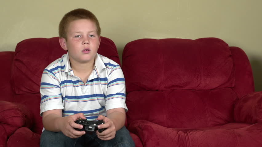 Video Stock A Tema Boy Gets Upset Playing Video 100 Royalty Free