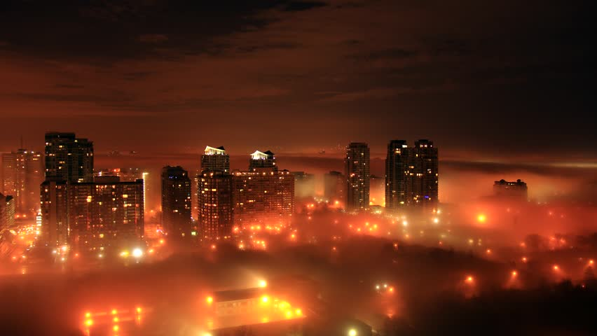 Foggy City Night Time-Lapse 2 (4K). Timelapse shot of a city late at night