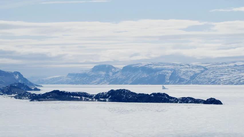 Arctic landscape and mountain range in Nunavut, Canada.