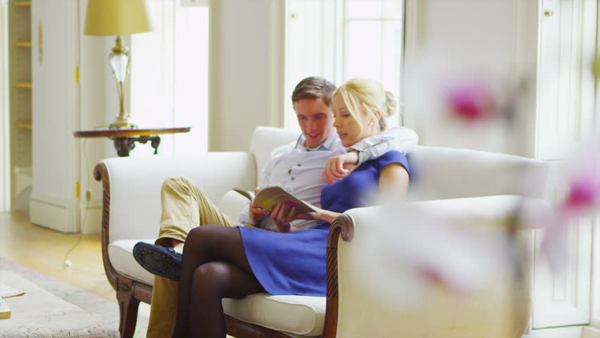 Attractive young couple relaxing together in elegant home
