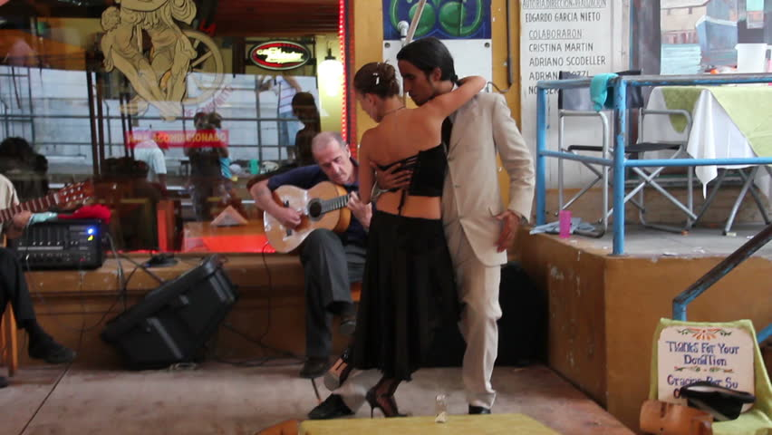 BUENOS AIRES, ARGENTINA - MAR 5: Tango dance on Mar 5, 2011 in Buenos Aires. Couple dances tango on touristic quarter of Caminito