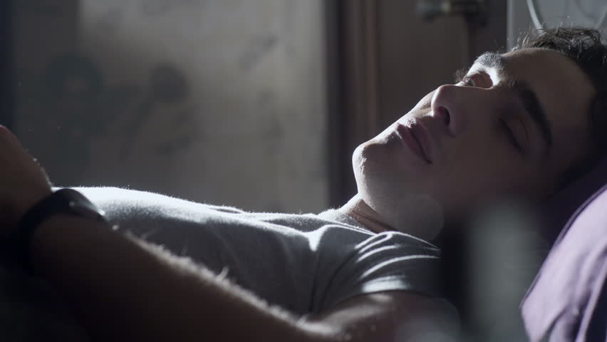Young man wakes up in the morning | Shutterstock HD Video #5249492