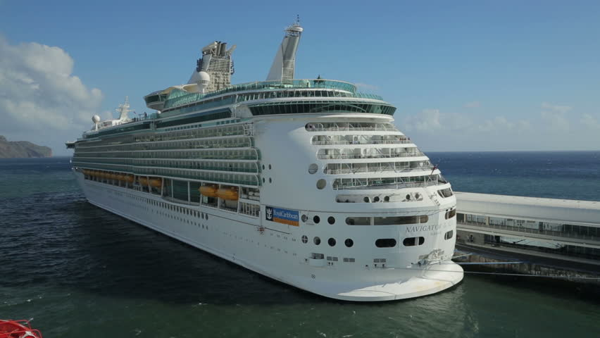 """FUNCHAL, MADEIRA/PORTUGAL - NOVEMBER 14: Navigator of the Seas cruise ship on November 14, 2013 in Funchal. The ship is a second generation """"voyager class"""" ship and will be upgraded in January 2014."""