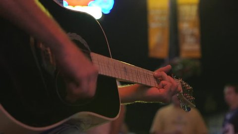 Busker playing guitar in downtown Nashville, Tennessee.