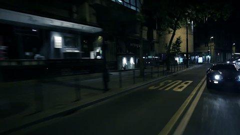 Beautiful diagonal shot of blue car overtaking at the city night ride