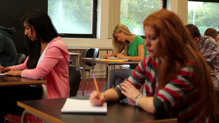 Concentrating students sitting in class and taking notes in a college | Shutterstock HD Video #5270495