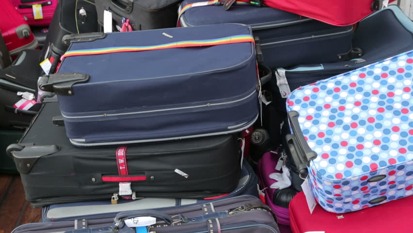 Tilt of luggage on cruise ship waiting to be off loaded | Shutterstock HD Video #5277695