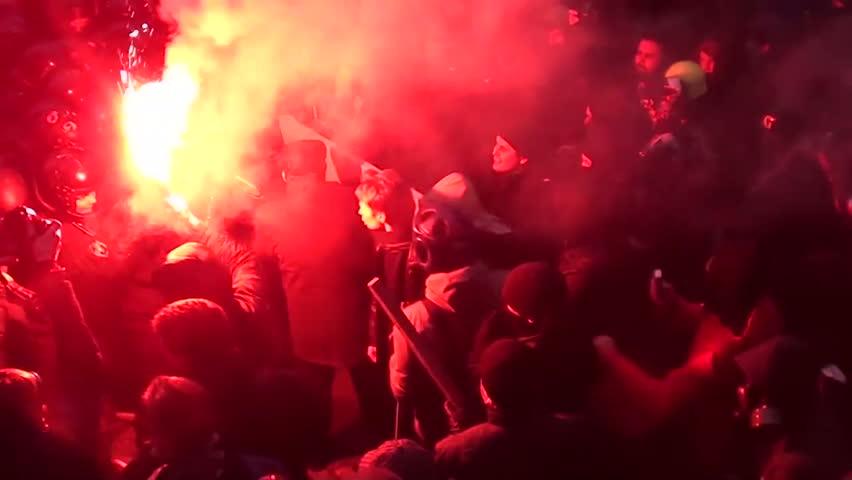 KIEV - DEC 1 2013:Ukraine Kiev. Storming of the presidential administration. Protesters clash with police