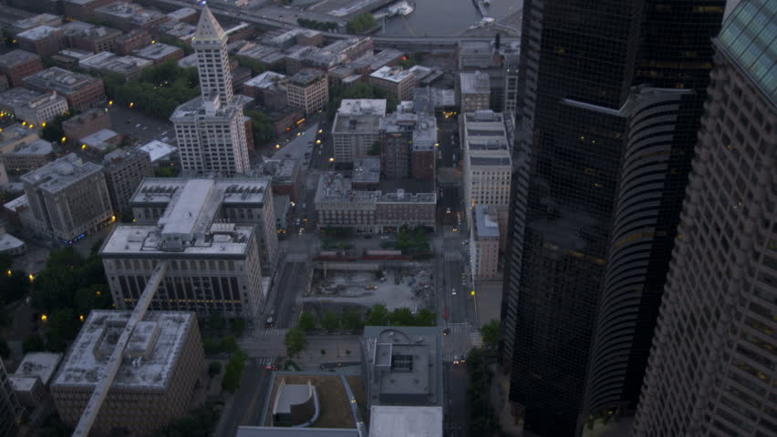 Aerial dusk overhead view of Columbia Center the Sea Tower Seattle skyscrapers Business Center city highway Pacific Northwest Seaport, Washington State, USA RED EPIC, 4K, UHD, Ultra HD resolution | Shutterstock HD Video #5300225
