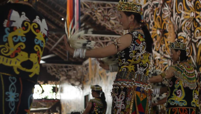 SAMARINDA, INDONESIA. CIRCA November 2013: Traditional Indonesian Dancers from Borneo (Pampang Village) perform the Tari Sakai Nyelamai,Tari Ajay, Tari Enggang Terbang and Tari Berburu