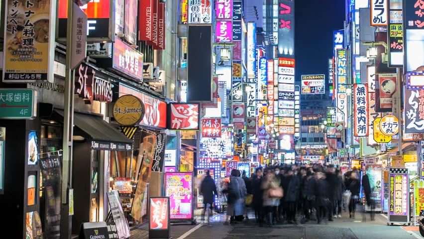TOKYO 2013 - Panning nighttime time lapse of people walking through the Kabukicho area of Shinjuku in Tokyo, Japan