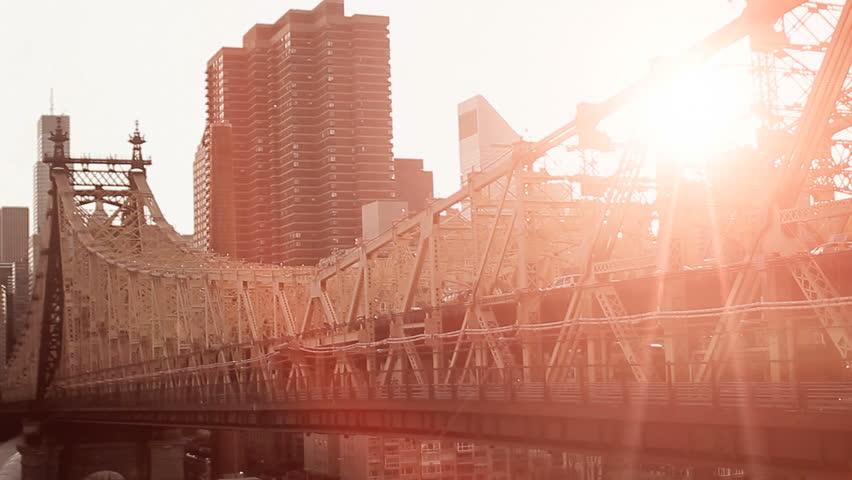 sunset city. bridge construction. dusk sun flare lens flare. 1080 cityscape urban