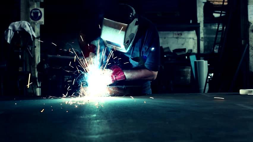 Welder working in melt workshop