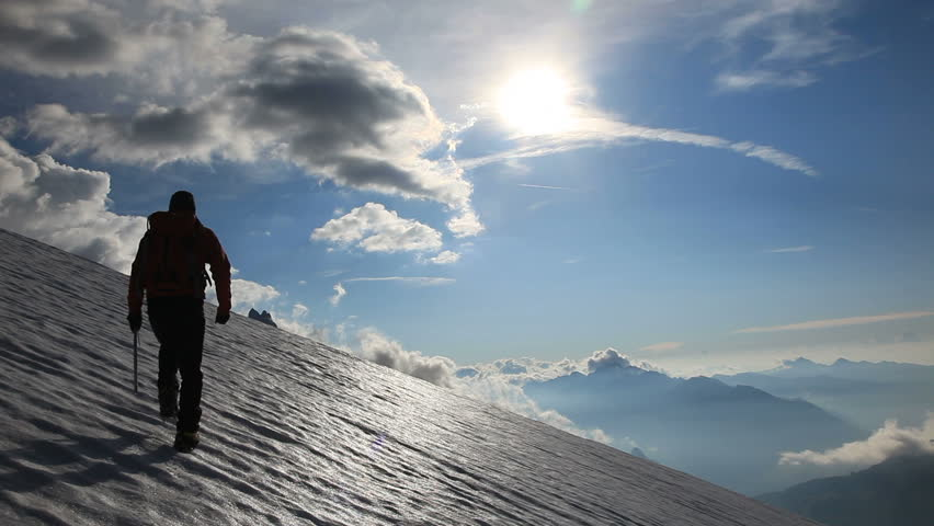A male mountaineer walking uphill on a glacier. Mont Blanc, France. HD1080P by Canon 5D MkII #5364761