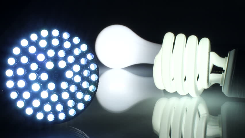 Concept shot showing old lightbulbs (CFL and incandescent) transitioning to new LED bulb with light on. Shot with a Canon 7D at 24p.