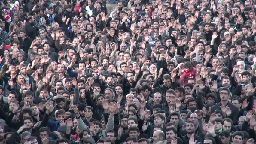 ZANJAN, IRAN - 15 NOVEMBER 2013: Crowds of Iranian men have gathered to take part in a sombre parade to commemorate the martyrdom of Hussain, as part of Ashura and Muharram, in Zanjan