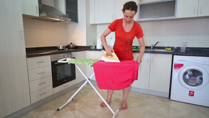 Beautiful Barefoot Housewife Ironing Laundry In The Large ...
