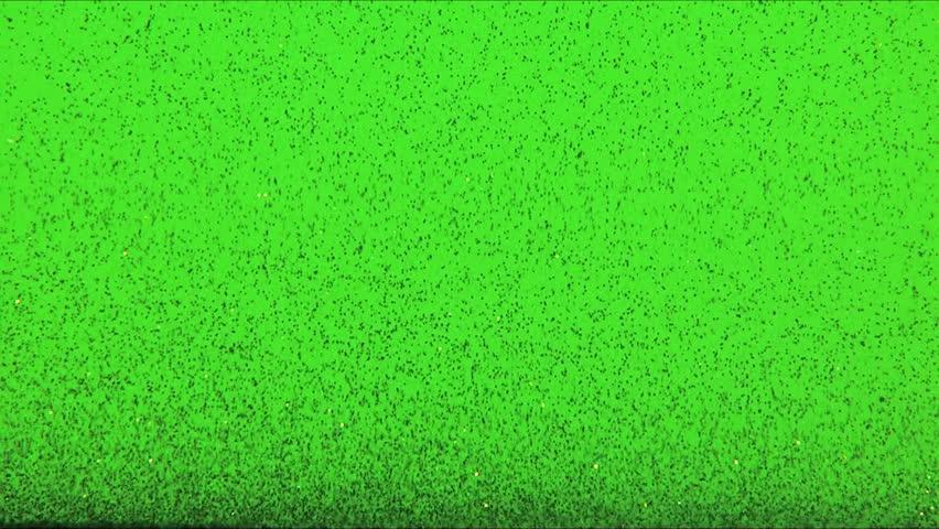 Falling black particles on green screen