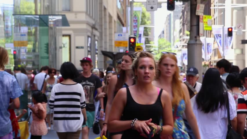 SYDNEY, AUSTRALIA - CIRCA 2014: People walk through George Street in Sydney, New South Wales, Australia