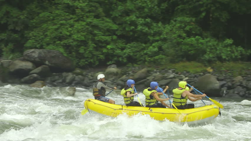 Group of six people white water rafting on Pastaza river, Ecuador