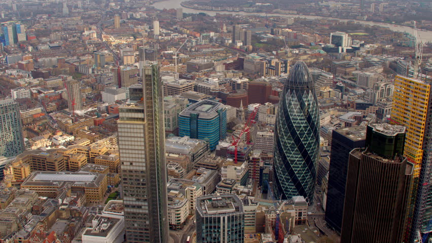 4K Aerial shot of Central London with view of the River Thames, The City Financial District, Liverpool Street, Gherkin, Tower Bridge, Tower of London