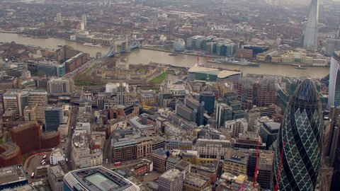 4K Aerial shot of Central London with a view of the River Thames, The City Financial District, Liverpool Street, Gherkin, Tower Bridge, Tower of London, Shard, Mayor's Office, HMS Belfast