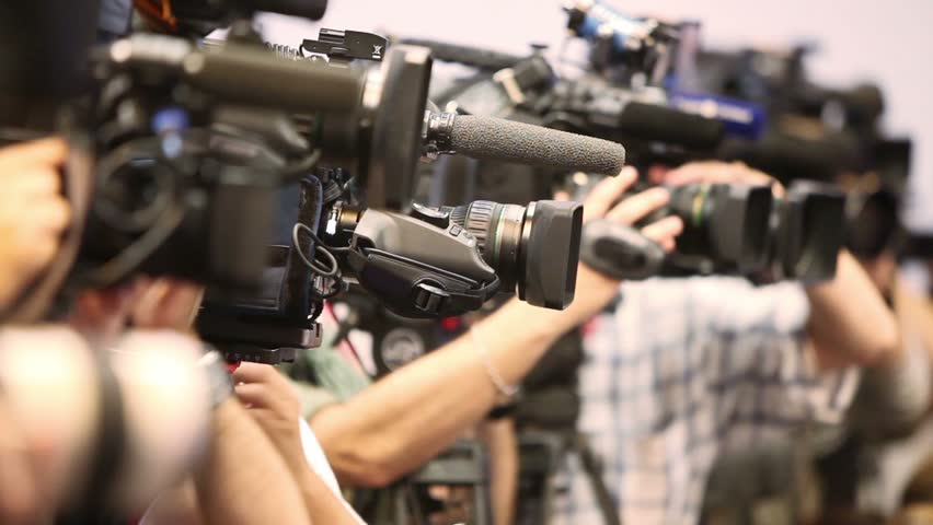 Several video operators with camcorders on tripods recording video at an event | Shutterstock HD Video #5534315