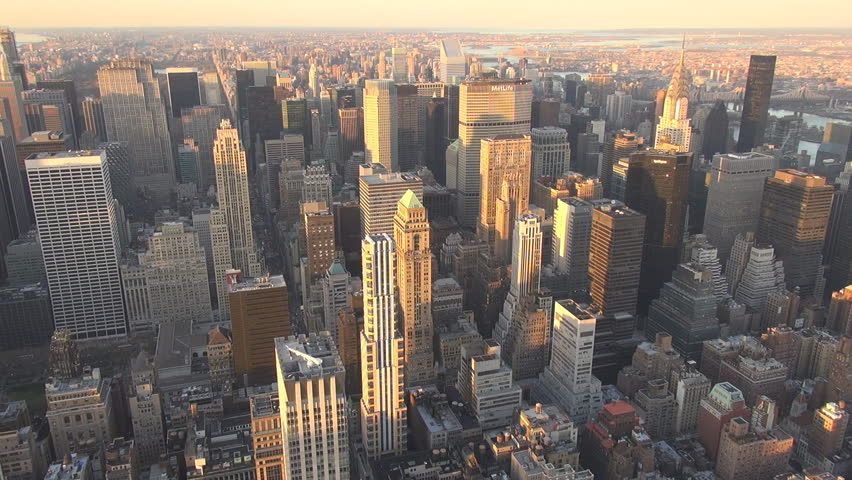 NEW YORK - USA, APRIL 21, 2013, Aerial view of skyscraper of business district at sunset | Shutterstock HD Video #5577995