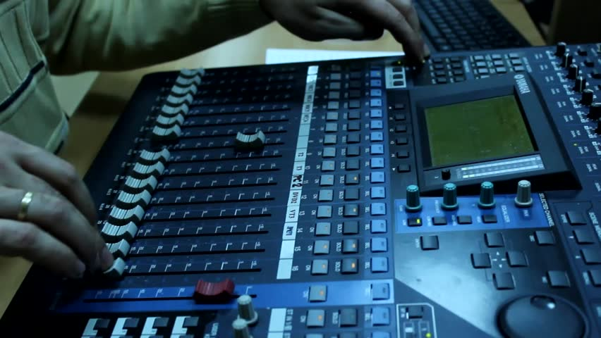 Man for the television audio mixer board  works | Shutterstock HD Video #5579426