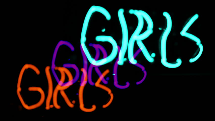 Girls neon sign, prostitution or peep show concept