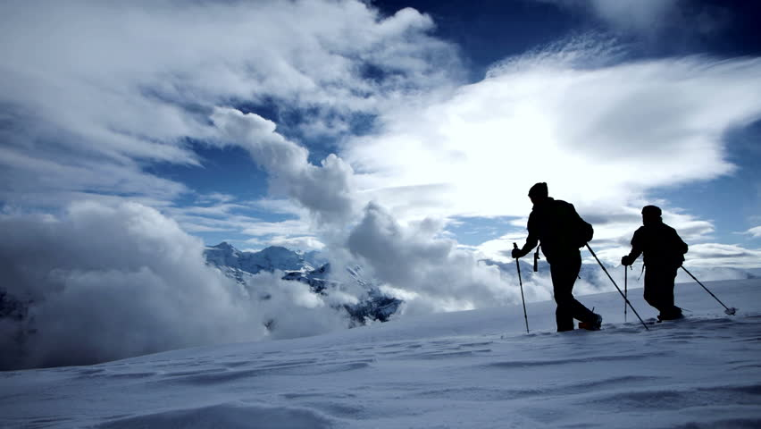 Hikers walking in the snow. expedition journey. foot feet steeps. snow winter. recreation activity sport. holiday vacation tourism. people persons silhouette. outdoors | Shutterstock HD Video #5594645