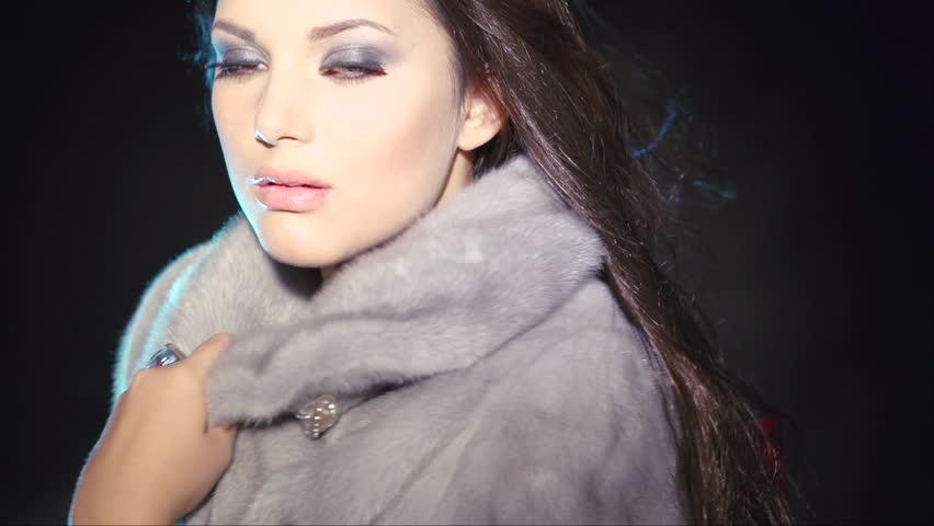 Beauty Fashion Model Girl in Blue Mink Fur Coat. Beautiful Woman in Luxury grey Fur Jacket . Winter Fashion, Blowing Hair in the snow. Isolated. Slow motion 1080. Slowmo