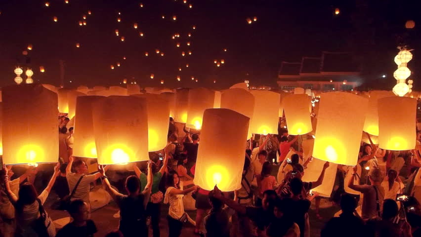 CHIANGMAI - November 16 : Unidentified People launch sky lanterns to the sky in Loy Kratong festival on November 16,2013 in Chiangmai,Thailand.