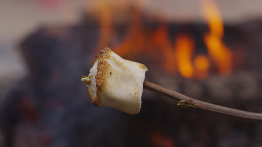 Roasted marshmallow by campfire. Shot on RED EPIC for high quality 4K, UHD, Ultra HD resolution.